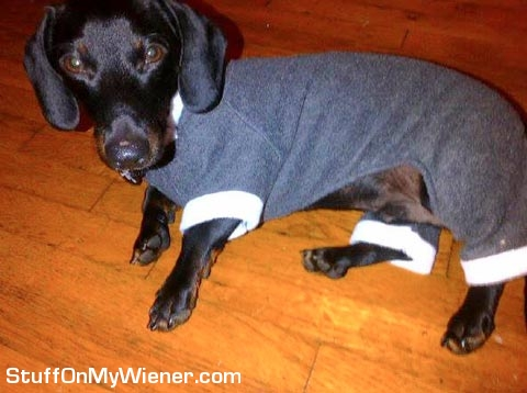 Myer wearing a sweater.